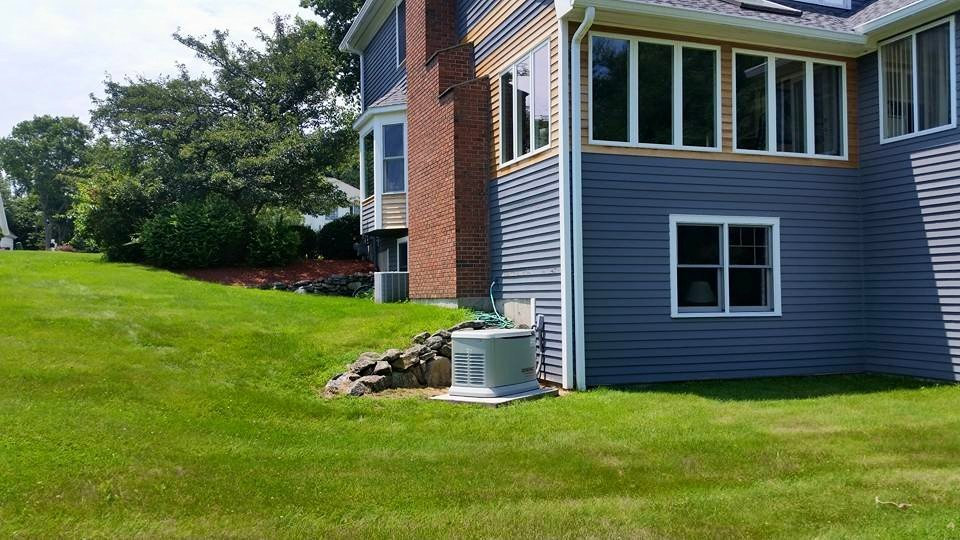 generator next to blue house